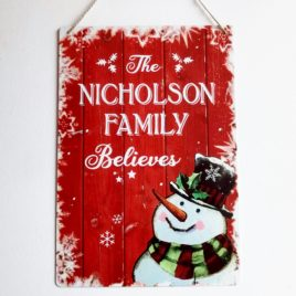 Family Name Believes Christmas Sign Vintage Snowman Metal Sign