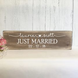 Wooden wedding just married sign