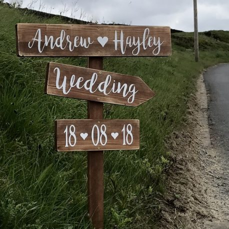 Signpost wedding this way sign